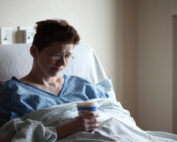 Woman in hospital bed.